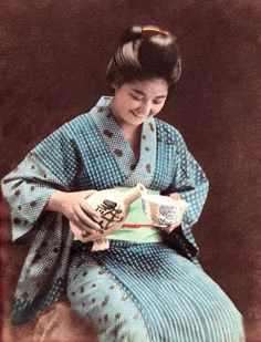 Miss Tokimatsu pouring a huge cup of sake, ca.1890s by K. Tamamura