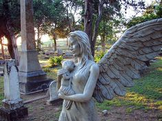 Angel and child by watsonsinelgin, via Flickr - Bastrop, Texas
