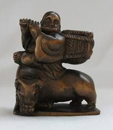 FINE OLD WOOD MAN ON BUFFALO NETSUKE