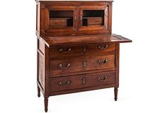 Antique Provençal walnut desk with brass hardware and screening.
