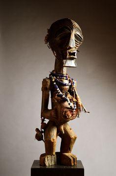 Songye nkisi power figure) with kifwebe (mask)