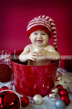Baby in a bin. Maybe I should put the kiddos in bins or buckets and surround it with Christmas stuff.