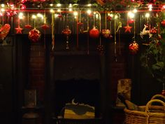 The Living Room Mantelpiece 2013. Detail of this year's theme: RED! Red flowers, red decorations and lights