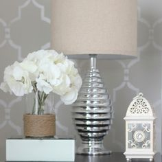 A DIY bedroom accent wall using a silver metallic and the Marrakech Trellis Allover Stencil. http://www.cuttingedgestencils.com/moroccan-stencil-marrakech.html