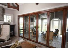 Folding Doors:  For between the sun room and the porch after we get it screened in?  And I love how they used the same floor tile in both spaces.