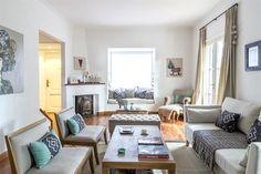 10 estilos para decorar un living  Para cerrar el área del living, en este espacio se eligieron dos butacas con base de madera en sintonía con la mesa ratona.  /Archivo LIVING