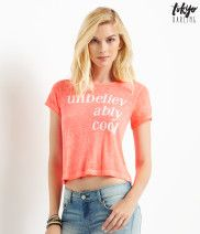 """Unbelievably Cool Crop Top Relaxed fit. Approx. length: 19"""" Style: 3868. Imported. 55% polyester, 30% cotton, 15% rayon. Machine wash/dry. Model height: 5'10""""; Size: Small."""