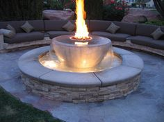Lovable Brick Patio Fire Pit Designs also Circular Retaining Walls from Stacked Slate Stone Tile with Built in Bench Plans and Lots of Rectangular Grey Cushions from Backyard Patio Ideas