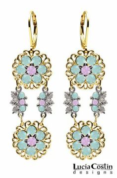 European Inspired Dangle Earrings Designed by Lucia Costin with Filigree Elements, 6 Petal Middle Flowers, Lilac and Mint Blue Swarovski Crystals; 14K Yellow Gold over .925 Sterling Silver; Handmade in USA Lucia Costin. $87.00. Unique jewelry handmade in USA. Lucia Costin flower shaped drop earrings. Mesmerizing enough to wear on special occasions, but durable enough to be worn daily. Flowers and fancy ornaments beautifully combined. Adorned with light purple and blue opal S...