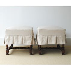 Slipcover with box pleats for small ottoman or stool.