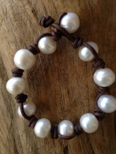 Classic white freshwater baroque pearl bracelet. Pearls are large, measuring about 12-13 mm in size. These pearls are radiant boasting the most beautiful luster! Each pearl is hand drilled, strung and
