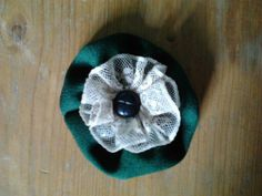 green flower with white lace and blak button- brooch