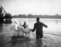 "Baptism in the Ohio River - 1919. This photo is now on display in ""Treasures in Black and White,"" a new and unique exhibit with historic photos in Cincinnati's history that will transport you back in time through the Queen City's remarkable history.http://bit.ly/1cFHe4V"