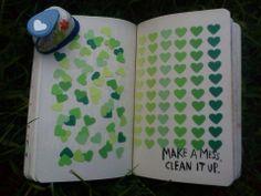 Perforeer gekleurd papier en plak de figuurtjes op papier. =)