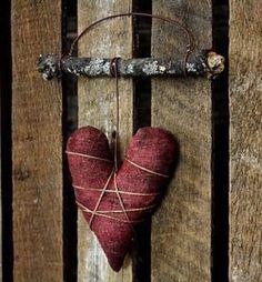 Felt heart on a branch.