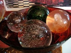 paper weights in a bowl... pretty for the living room too...