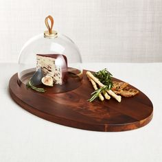 Sale ends soon. Shop Prospect Serving Board with Glass Dome. We've elevated mixed materials to an art in our Prospect collection designed by Ana Reza-Hadden. Crate And Barrel, Glass Serving Bowls, Serving Trays, Walnut Stain, Serving Board, Glass Domes, Serveware, Chrome Plating, Decoration