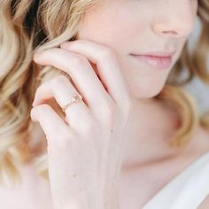 "Pink "" morganite""  Emerald cut center stone, two triangle diamonds, three stone ring $1,285.00"