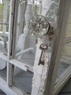 Linda makes the conservatories out of old windows. Then she mosiacs onto the front of the doors