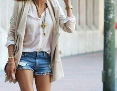 Casual layers: denim shorts, white shirt, beige cardigan, gold accessories