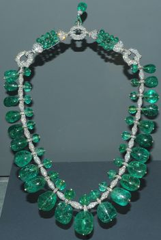 Indian Emerald Necklace - This Art Deco, Indian-style necklace features 24 emerald drops of graduated sizes, adjoined by a smaller emerald bead. All are set in platinum with hundreds of small diamonds.