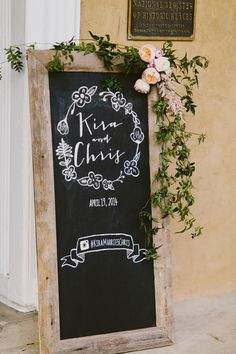 Chalkboard Welcome Sign | Redfield Photography | TheKnot.com I like the garland added to the top corner.