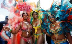 US actress Tatyana Ali (left) poses with her sisters Anastasia and Kimberly  during their 'Butterflies, Beasts & Bacchanal' presentation on the final day of the #Trinidad and #Tobago #Carnival  at Queen's Park Savannah in Port of Spain