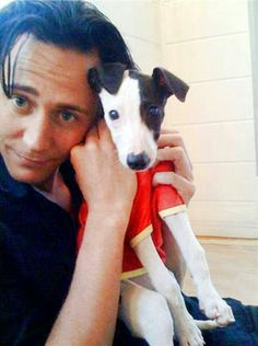 Well fudge that's a cute puppy. Tom ain't bad either.