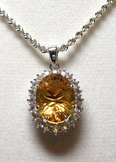 Heliodore accented with white topaz pendant  w/ by Michaelangelas, $212.50