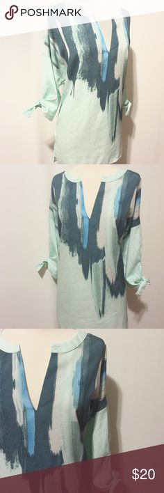 """✨ Mint & Teal Modern Print Tunic Effortless chill! Semi transparent fabric keeps you cool. Mint teal white and denim colors come together in a modern print. Modified v-neck with 3/4"""" framing, elbow length sleeves with self tie and 2"""" band, 4"""" slits.  100% poly  Machine washable   48"""" bust  29""""overall length New York & Company Tops Tunics"""