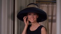 Nothing is more glamorous than a big, beautiful hat and a smile!