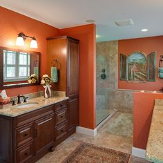 The wall dividers (full height and partial walls) add pockets of privacy in this bathroom layout.