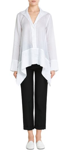 Made from airy ramie, Donna Karan New York styles this white tunic with an understated modernity. The asymmetric detail on each side of them hem adds volume and interest #Stylebop