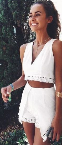 matching white crop top and shorts with fringe
