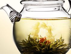 tea kettle and jasmine flower