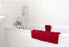 White Bathtub With Chrome Fixtures An Handheld Showerhead