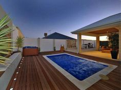 Swimming pool with timber deck and lighting