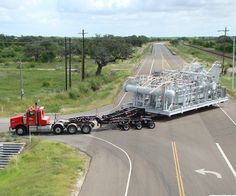 KW T800 triaxle with 3 axle jeep and probably a expandable RGN hauling a gas module unit.........
