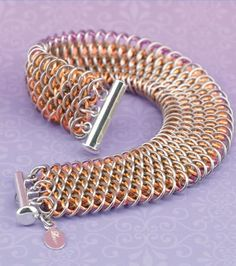How pretty is this Baby Pink Dragon Scale bracelet? Incorporating pink jump rings into chain mail jewelry designs give the hard metal a softer touch. Either way, the dragonscale weave is such a pretty design on its own.