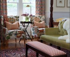 Sarah Richardson designed country style bedroom with bold red, green, and yellow home decor Sarah Richardson Farmhouse, Sarah Richardson Bedroom, Home Bedroom, Bedroom Decor, Master Bedroom, Bedroom Seating, Farm Bedroom, Bedroom Drapes, Bedroom Chair