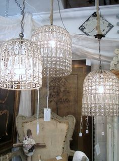 Make your own gorgeous chandeliers with a wire basket, spray paint and chandelier pieces.