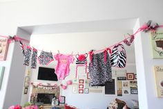 Pink and zebra print baby shower theme. The game where you show the string of decorated clothes and make them guess what was on it