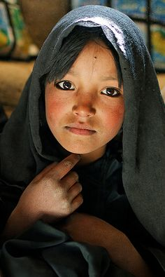 Afghan school girl, she's about ready for marriage.