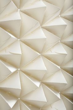 Benja Harney, Australian based paper artist, has a new series of exploration in paper surrounding Platonic Solids. His latest exhibition encompassed making these forms with the use of paper only and NO GLUE! Each miniature paper crafted object interlocks into one another creating stunning patterns.
