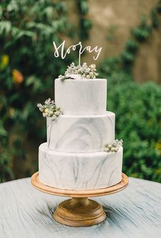 Brides.com: . Marble-frosted wedding cakes always make us say 'Hooray!'
