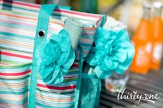 Pack a picnic in your Zip-Top Organizing Utility Tote – use the Floral Clips to make your napkins even prettier!