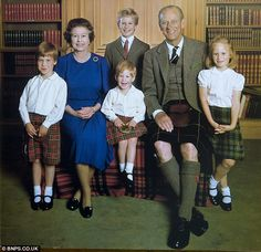 Family snap: The Queen and Prince Philip pose with their grandchildren (l-r) William, Harry and Zara in a warm portrait