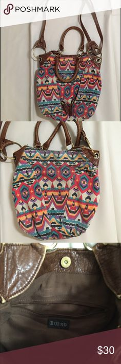 Tribal Print Purse This bag is in great condition.  It has two pockets on the outside and one on the inside. It comes with short handles and a long shoulder bad strap. The strap can be taken off. Bags Crossbody Bags
