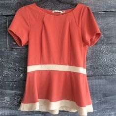 Beautiful Peplum blouse This well made slight peplum top is beautiful and flattering on! Great color and practically new. From a boutique. Stretch in the fabric Tops Blouses
