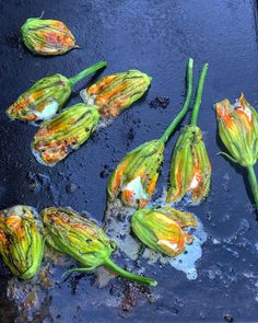 Delicate courgette flowers filled with buffalo mozzarella on the BBQ. They take only a couple of minutes to cook. Vegetarian barbecue or #VBQ is a big project for me. Vegetarians and vegans also love to eat flame  grilled food outdoors- meat isn't necessary for delicious bbq.  #homemade #france #bbq #vegetarian #creativecooking #outdoors #plantbased #travel #food